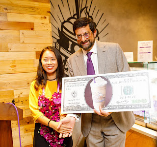 The Coffee Bean and Tea Leaf BIA's 3 millionth customer with Roman Scott-Chairman of The Coffee Bean and Tea Leaf