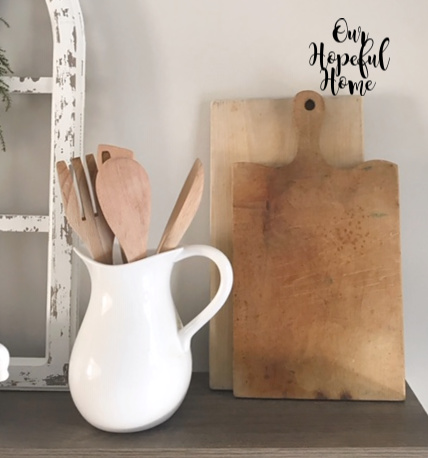 ironstone pitcher wooden utensil spoons cutting boards