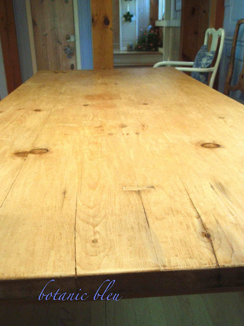 After stripping a reclaimed old English pine table, a few water stains remained