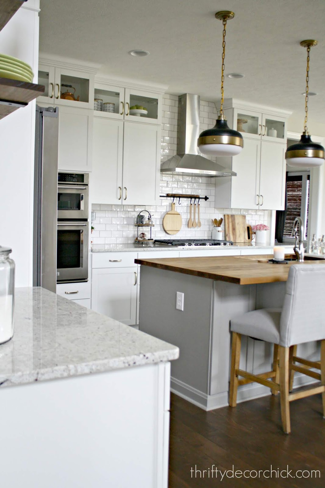 White kitchen cabinets gray island
