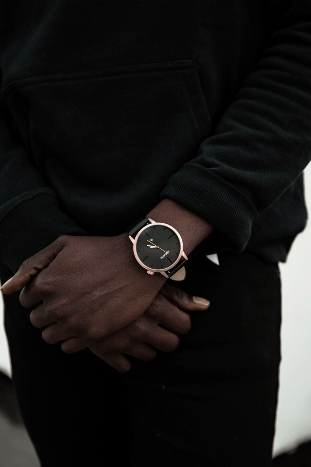 a close up picture of a men wearing watch on a hand