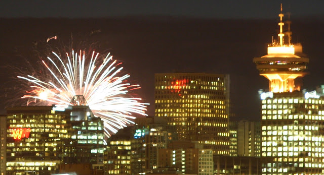 Vancouver skyline with Woodwards 'W' Neon sign and fireworks.