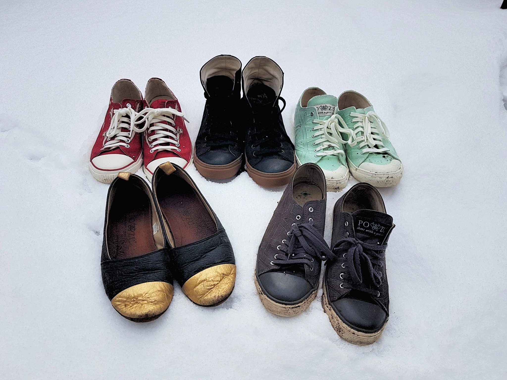five pairs of Po-Zu shoes sitting in crisp white snow