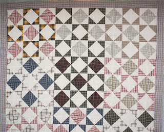 half square triangle quilt with first border