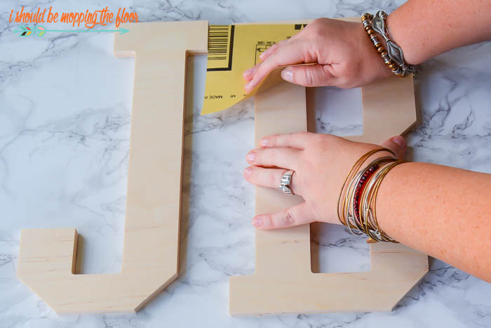 Buffalo Check Wooden Letters | Paint these fun patterned and preppy letters in an afternoon. Super cute for kids' spaces.