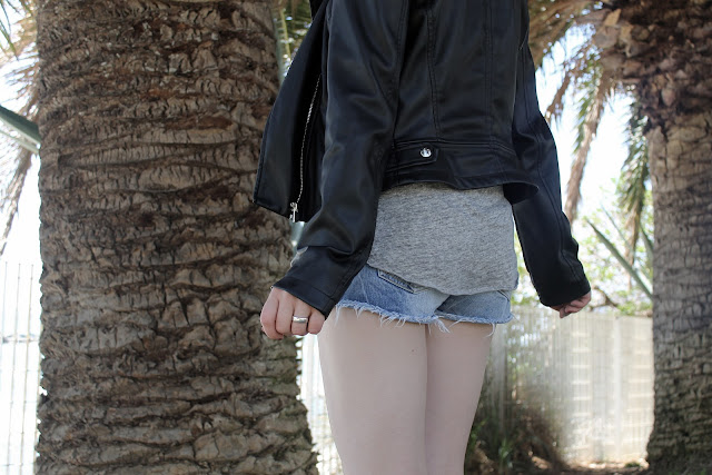 shorts and leather jacket