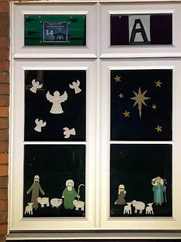 Shepherds in an advent window