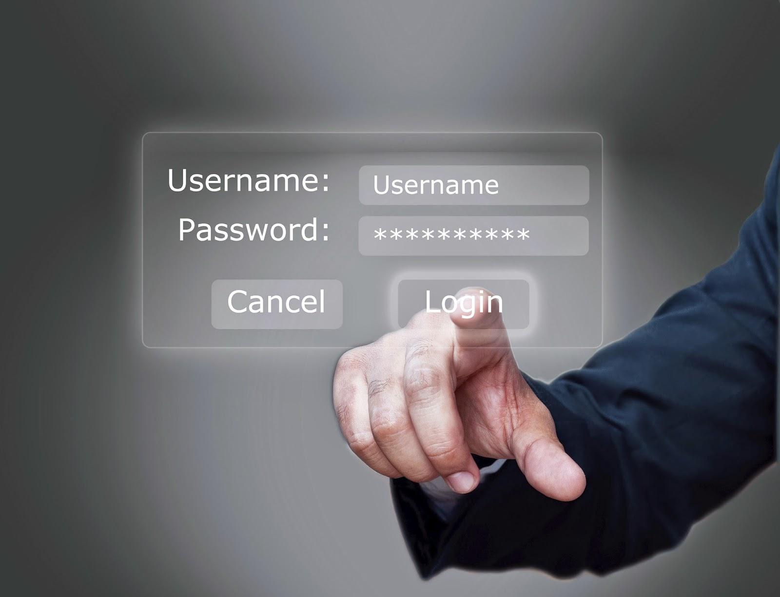 Hand entering information on login screen