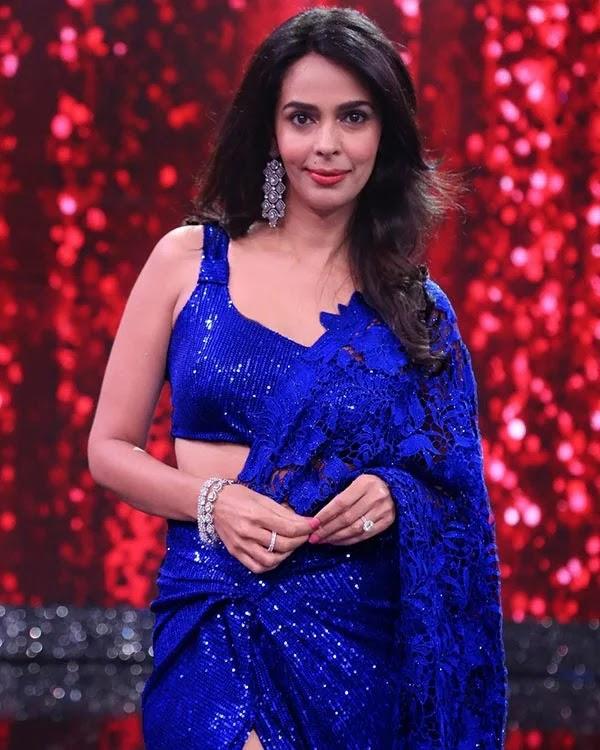 Mallika Sherawat in blue shimmery saree looks sizzling hot as she appears in Zee Comedy Show.