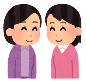 笑顔で向き合う人たちのイラスト(女性と女性)