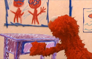 Elmo use his hands to open the drawer. Sesame Street Elmo's World Hands Quiz