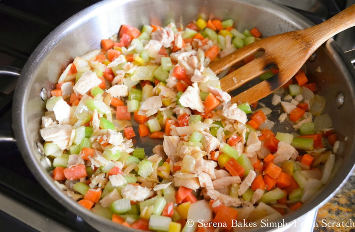 Garlic, Carrots, Celery, Garlic Powder, Tuna in a pan.