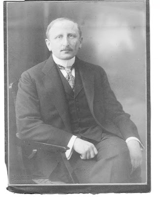 Richard Neumann, dressed in a formal suit. Monochrome.