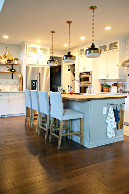 Wood tones in white and bright kitchen