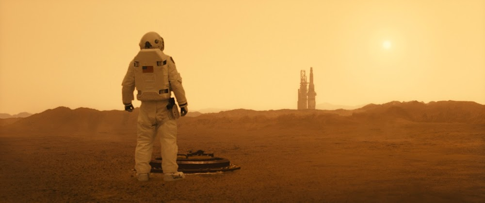 Astronaut looking at rocket launch pad on Mars - image from Ad Astra movie