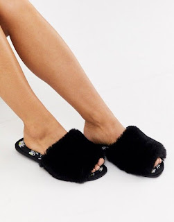 ASOS DESIGN Zero daisy print fur slider slippers in black