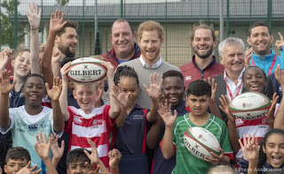 Duke of Sussex at Rugby with kids whilst Meghan launches capsule collection