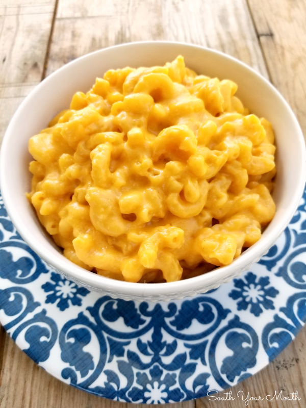 No-Boil Crock Pot Macaroni & Cheese | An impossibly easy slow cooker recipe for ultra-creamy Mac & Cheese that uses uncooked macaroni noodles. No boiling or baking required and no sauce to cook – just toss it in and go!