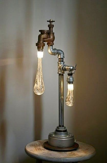 Creative Lighting Fixtures That Look Truly Stunning Plumbing Materials Bicycle Parts Hats Wooden Tennis Rackets And Even Old Rusted Milk Bucket Are