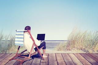 man using laptop on the beach. Dreamy lifestyle
