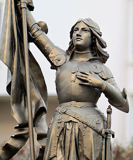 status of joan of arc holding her banners