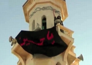Hezbollah places a Ya Husayn banner on a  Sunni mosque in Qusayr, Syria