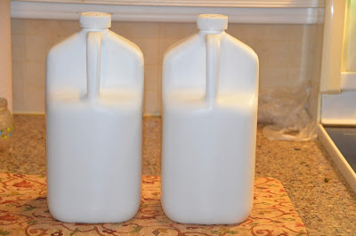 (l-r) containers of shampoo and conditioner
