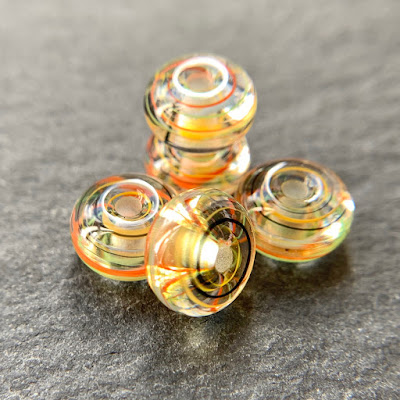 Handmade lampwork glass beads by Laura Sparling made with CiM Circus Tent