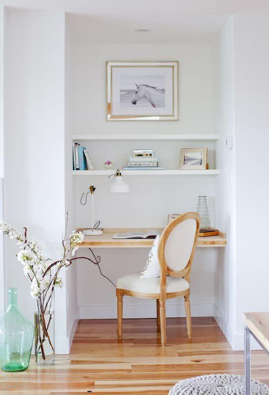 Navy blue home office with wall mounted desk