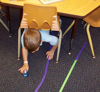 Masking tape roads under table (Brick by Brick)