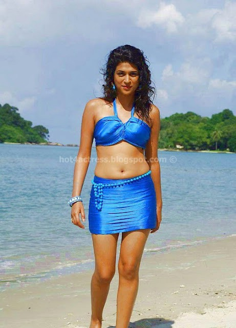 Shraddha Das Hot show in blue dress on Beach Hot Pics