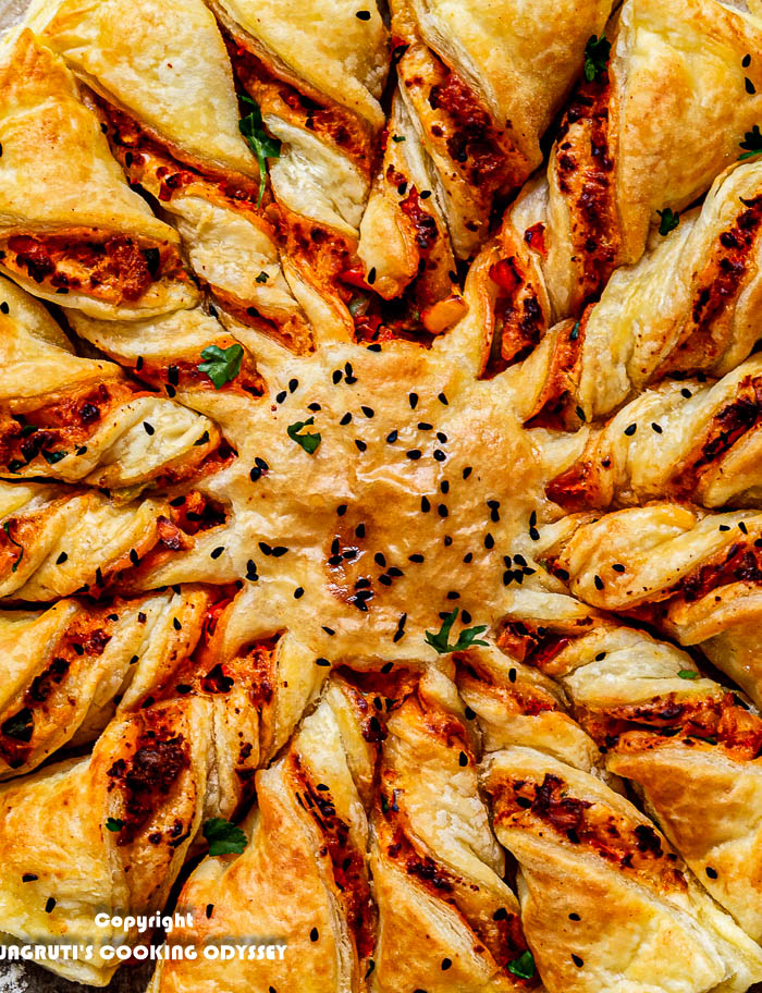 A zoomed image of Tandoori Paneer Tarte au Soleil with flaky puff pastry