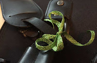 """Wrap colorful Kreinik 1/4"""" Ribbon on your suitcase handle for an easy identifier"""