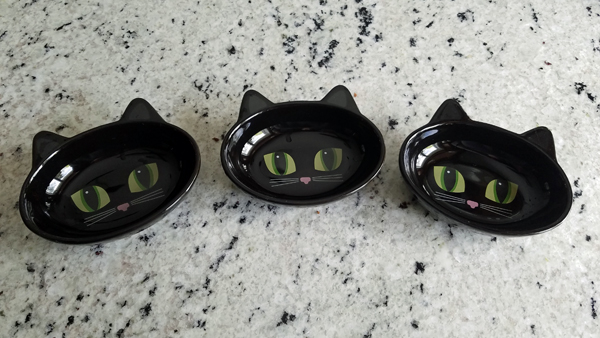 image of three bowls that look like cat faces