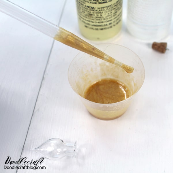 STEP 3: FILL THE VIAL Now use the pipette to transfer the gold resin into the tear-drop glass vial.