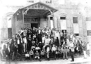 José Martí poses with workers in Tampa, Florida in 1893