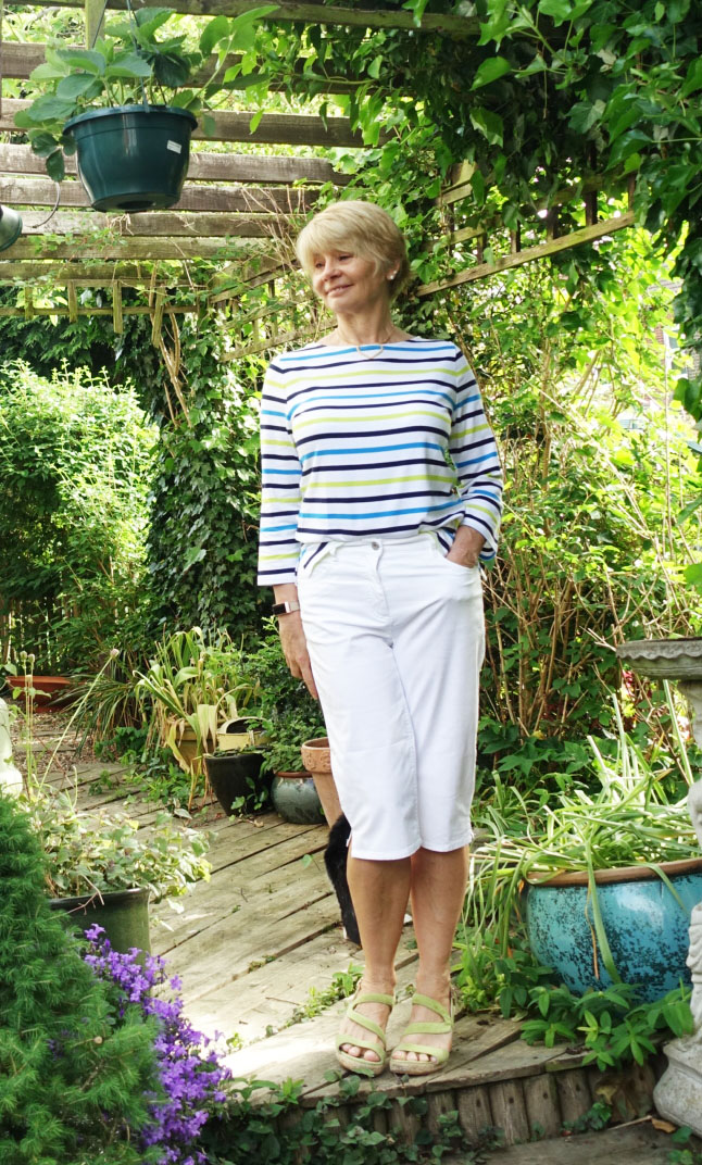 Smart casual wear: Breton top and white shorts with lime green wedges
