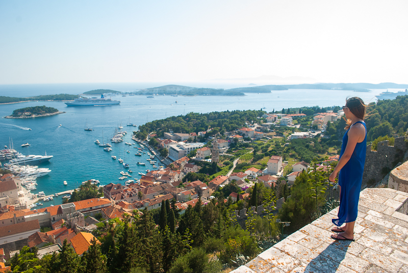 looking out at the view of hvar in a summer outfit
