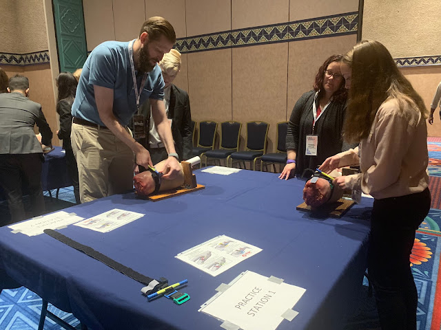 USU's Dr. Craig Goolsby demonstrates how to use a tourniquet for high school students at a 2019 conference in Orlando, Florida.