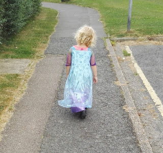 Toddler wearing her elsa dress