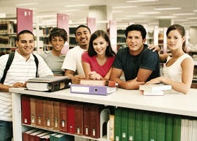 Student peers at a library.