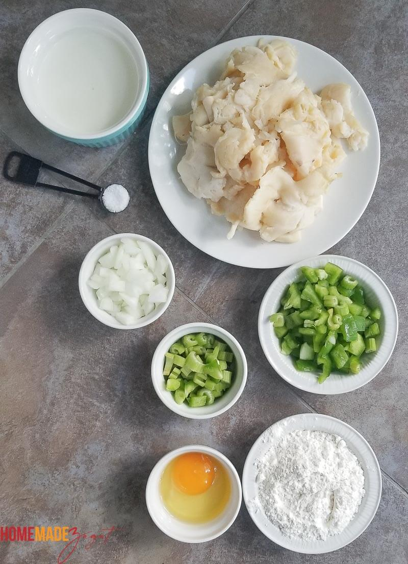 Ingredients for making Bahamian conch fritters: conch, egg, onion, celery, flour, milk