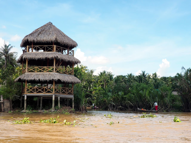 Wooden structures and fishing boats in the canals of the Mekong Delta, Vietnam