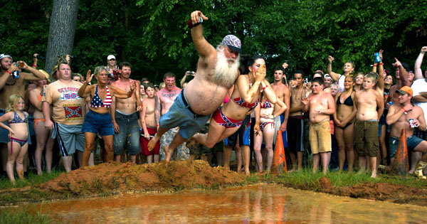 ultimate redneck party. Mud pool, beer, flag bikinis and cutoffs. Celebrate While You Can. marchmatron.com
