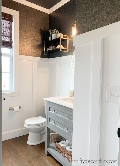 white board and batten bathroom with dark wallpaper