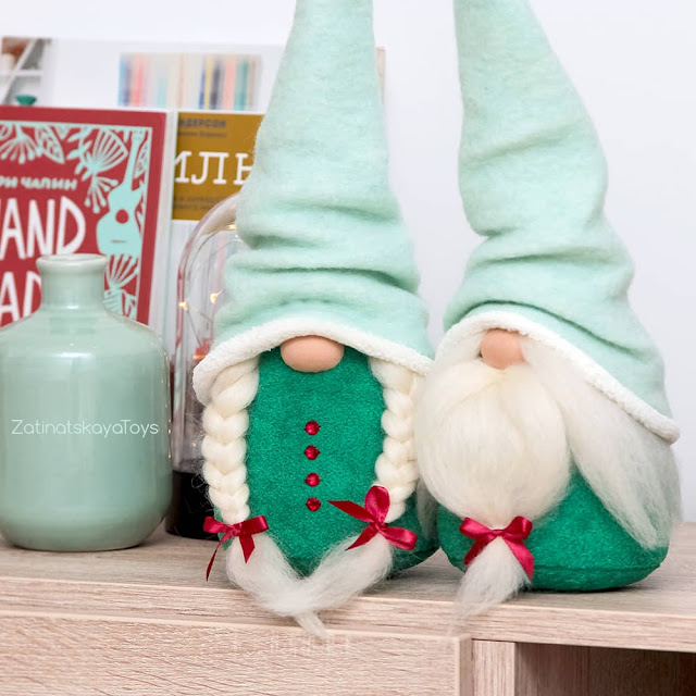 two handmade Christmas gnomes with mint hats by sewing patterns of Zatinatskaya Natalia