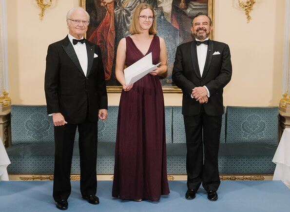 Princess Stephanie in ralph lauren halter v-neck satin maxi evening gown. Elie Saab dress. Christian Dior classic pearl earrings and pearl necklace