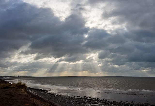 Photo of a wider view of the dramatic sky over the firth