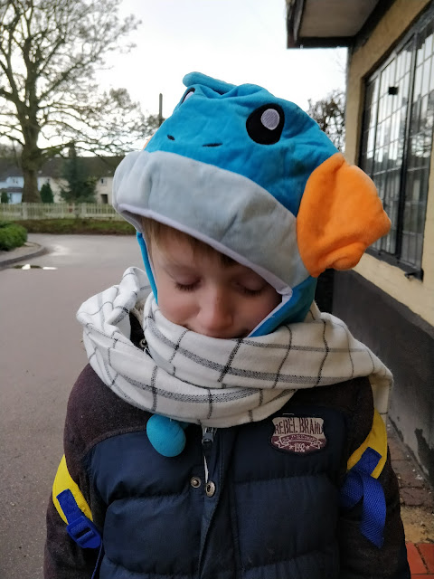 child with aspergers wearing pokemon hat and Fairy Tail Natsu scarf