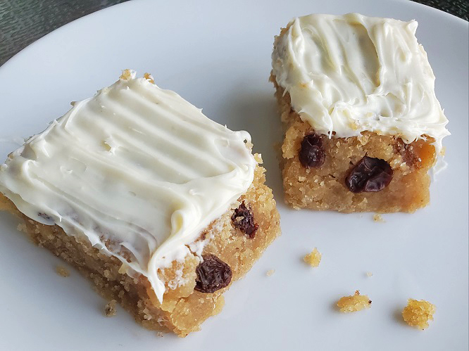 these are spice bars with white cream cheese frosting on top